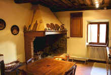 Traditional kitchen in a Volpaia house